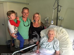 Great grandson Jackson, grandson Brad and grand-daughter-in-law Bel Cone with Eva Cone celebrating her 100th birthday