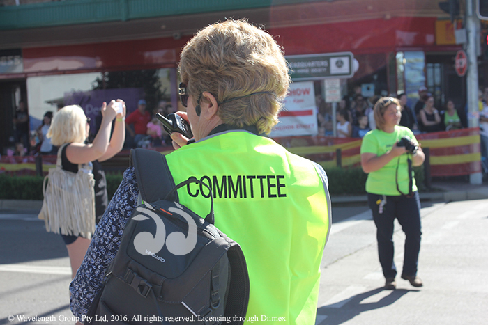 Lee Watts, president of the Horse Festival, coordinating the parade on the walkie-talkie.