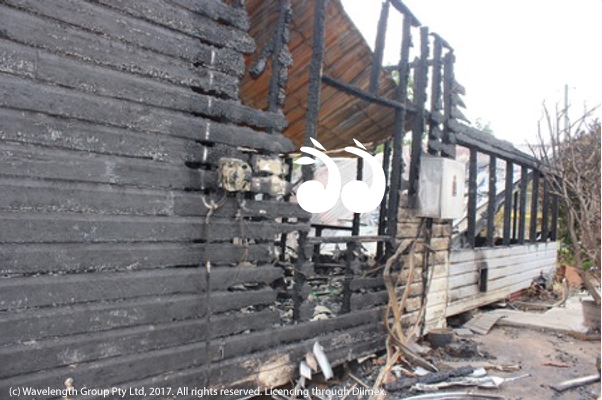 The southern side of the house, showing the window of the bedroom where the fire is believed to have been ignited.