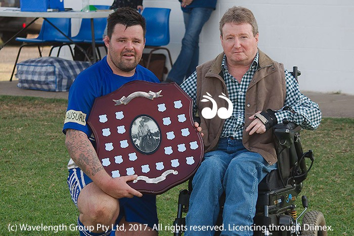 Captain Wes Suckley holding the Johnny Lawler Memorial Trophy, with Phil Eveleigh.