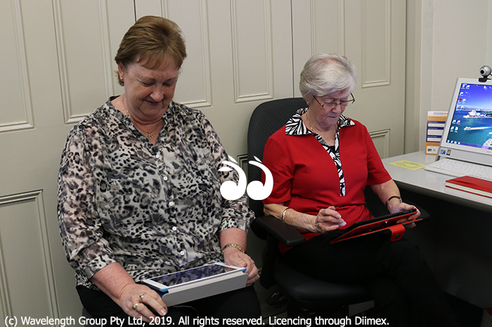 Learning to go online: Shirley Reichel and Jenny Dunn.