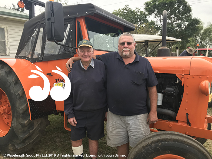 Ian and Lionel Morgan beside Brian's Chamberlain 9G tractor.
